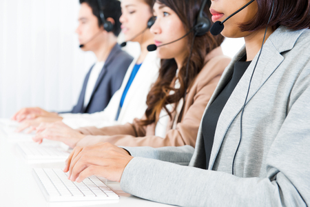 telemarketer: Call center (operator or telemarketer) team - telemarketing and customer service concept Stock Photo