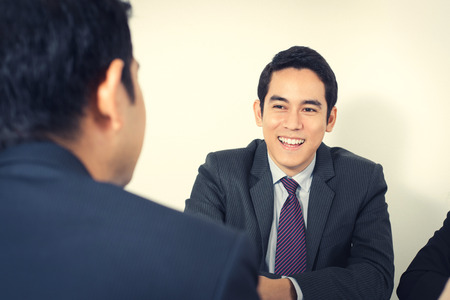 asian guy: Happy young Asian businessman in the meeting Stock Photo