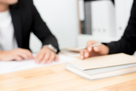 Blurred hands of businessmen on conference (meeting) table
