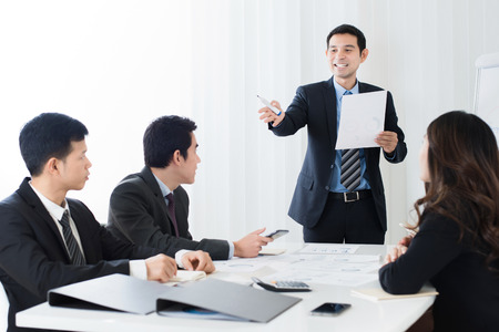 Businessman as a meeting leader asking for an opinion in the meeting