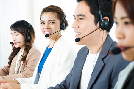 Call center (operator or telemarketer) team - telemarketing and customer service concept Stock Photo