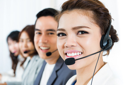 service broker: Smiling call center team - customer service, telemarketer and operator concepts Stock Photo