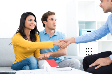 buyer: Young couple meeting with real estate agent (or financial adviser) at home