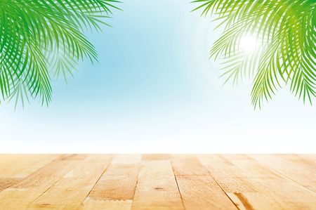Wood table top on summer tropical sky background with green coconut leaves - can be used for display or montage your products