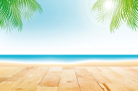 Wood table top on summer beach background - can be used for display or montage your products