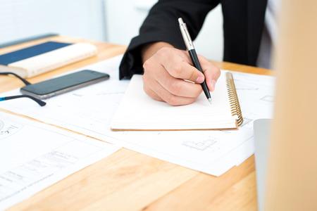 hand writing: Businessman hand writing on notebook