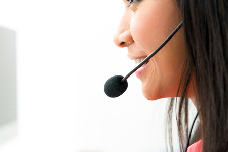 microphone headset: Woman wearing microphone headset - call center and customer service concepts