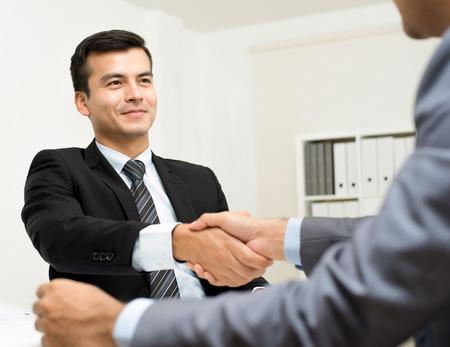 handclasp: Businessmen making handshake in the office