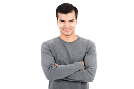 long sleeve: Portrait of happy smiling man wearing casual gray t-shirt, crossing his arms - isolated on white background
