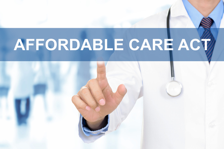 affordable: Doctor hand touching AFFORDABLE CARE ACT sign on virtual screen Stock Photo