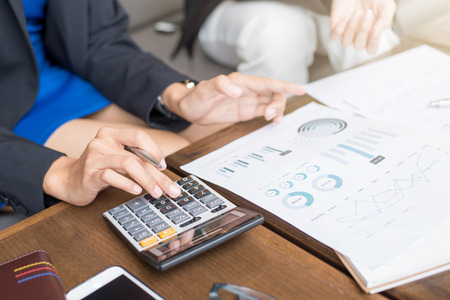 financial planner: Business people calculating and discussing financial documents - financial assessment and evaluation concepts