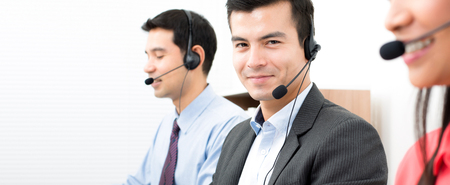 contact center: Business people working in call center - panoramic background