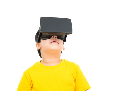asian boy: Cute little boy watching video on VR (or Virtual Reality) glasses