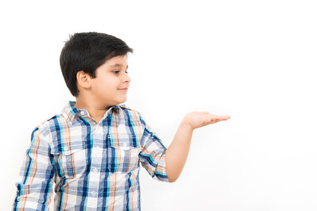 open palm: Cute Asian boy looking at empty open palm (hand) Stock Photo