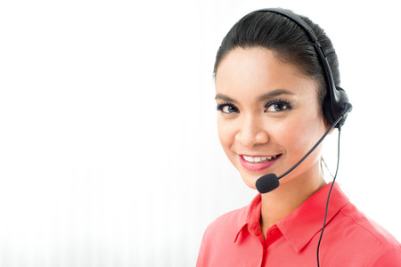 Woman wearing microphone headset as an operator or call center staff