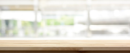 Wood table top on blur kitchen window background, panoramic - can be used for display or montage your products (or foods) Imagens - 65692160