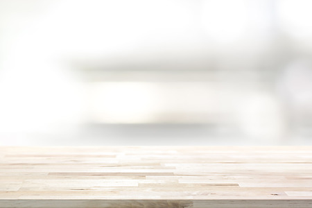 Wood table top on blur kitchen shelf background - can be used for display or montage your products (or foods) Imagens