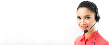 Asian woman wearing microphone headset as an operator or call center staff - panoramic banner with copy space