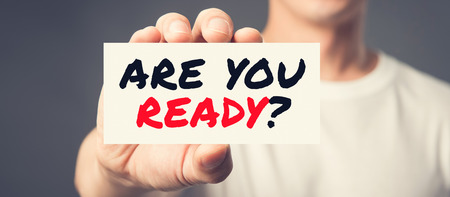 readiness: ARE YOU READY? message on the card shown by a man, panoramic banner