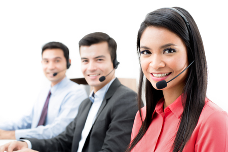 telemarketer: Smiling call center (or telemarketer) staff in the office Stock Photo