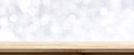 Wood table top on  abstract white bokeh background, festive theme
