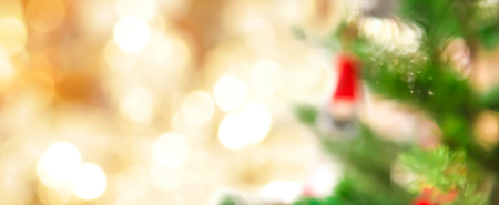 xmas background: Blur Christmas tree and gold bokeh, festive theme panoramic banner background Stock Photo