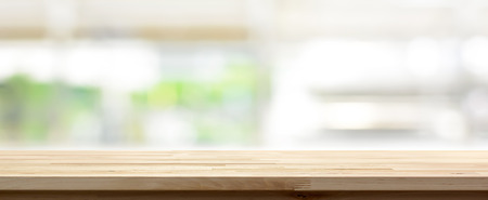 Wood table top on blur kitchen window background, panoramic banner - can be used for display or montage your products (or foods) Imagens - 66037747