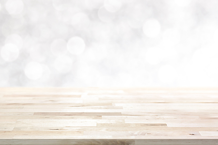 Wood table top on  abstract white bokeh, Christmas and festive theme background 스톡 콘텐츠