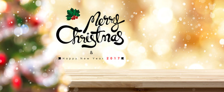 top of the year: Merry Christmas and Happy New Year 2017 table top panoramic banner background, golden theme Stock Photo