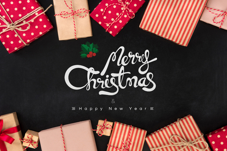 decorating: Merry Christmas and Happy New Year text with gift boxes on blackboard background