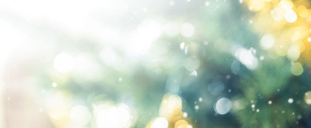 Blur bokeh abstract background from decorated Christmas tree, panoramic banner