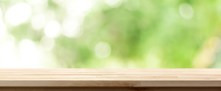 Wood table top on natural bokeh green background, panoramic banner - can be used for display or montage your products