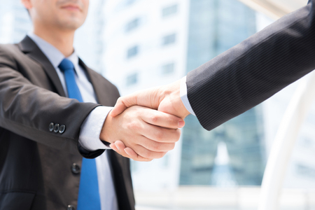 Businessmen making handshake - greeting, dealing, merger and acquisition concepts