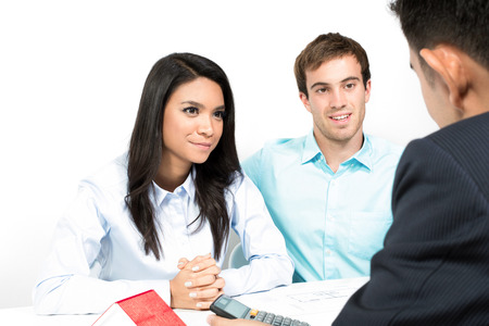 Interracial couple meeting with financial adviser Stock Photo