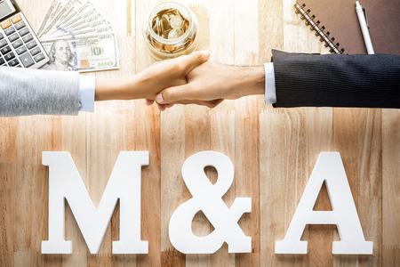 M & A (or Merger and Acquisition) Foto de archivo