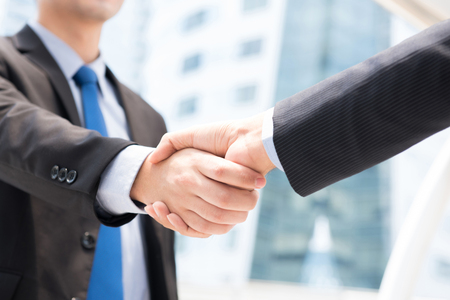 handclasp: Businessmen making handshake - greeting, dealing, merger and acquisition concepts