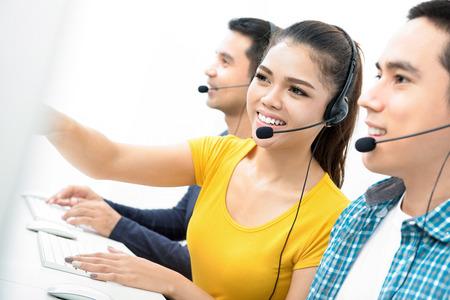Casual Asian call center (or operator) team Stock Photo