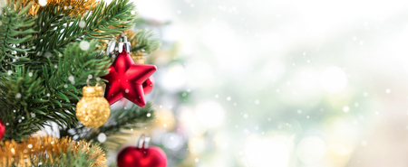 Close up of colorful ornaments on Christmas tree, panoramic banner background Foto de archivo
