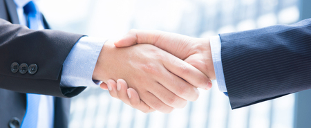 Close up of businessman hands making handshake, panoramic banner
