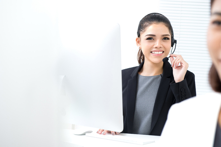 Young Asian businesswoman in call center Stock Photo