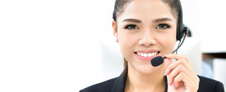 Smiling beautiful woman as call center staff, panoramic banner background with copy space