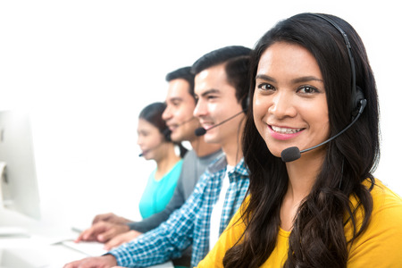 Smiling casual call center (or telemarketer) team Imagens