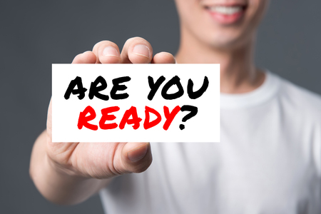 ARE YOU READY? message on the card shown by a man
