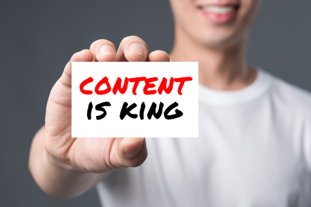 CONTENT IS KING, message on the card shown by a man Stock Photo