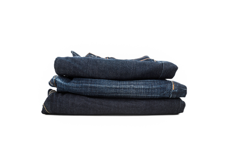 Stack of dark blue jeans - isolated on white background