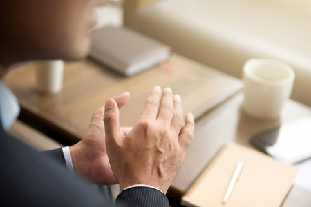 Businessman clapping his hands in cafe Stock Photo