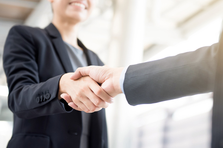 Businesswoman making handshake with a businessman -greeting, dealing and congratulation concepts etc.