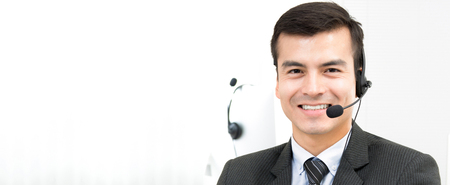 Handsome hispanic businessman working in call center - panoramic banner background