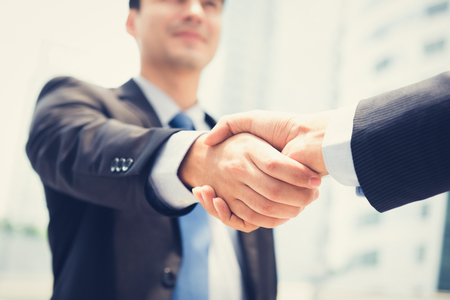 handclasp: Businessman making handshake - success, dealing, greeting & business partner concepts Stock Photo