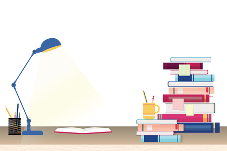 Stack of books and stationery on study table - education concept
